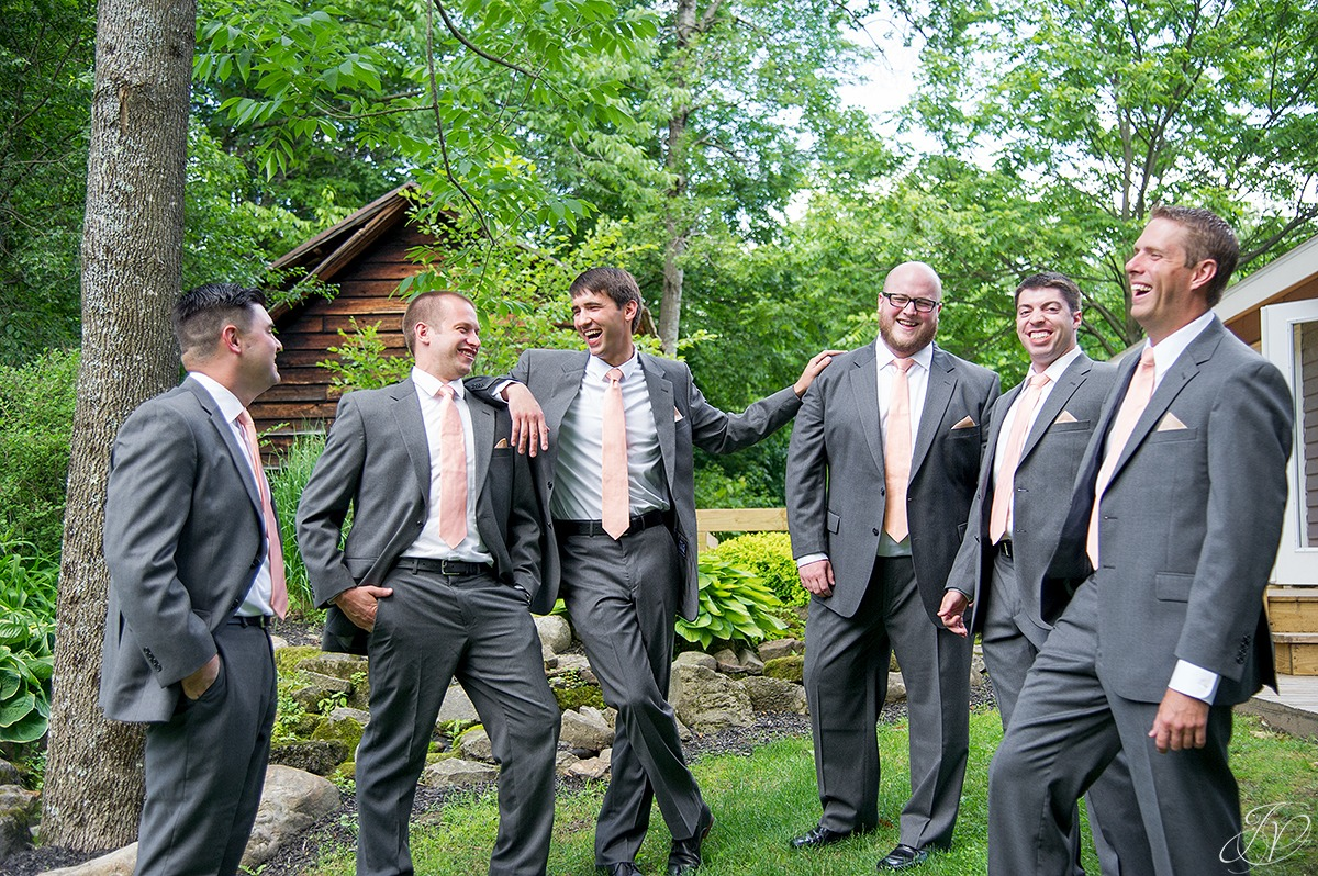 candid fun shot of groom with groomsmen