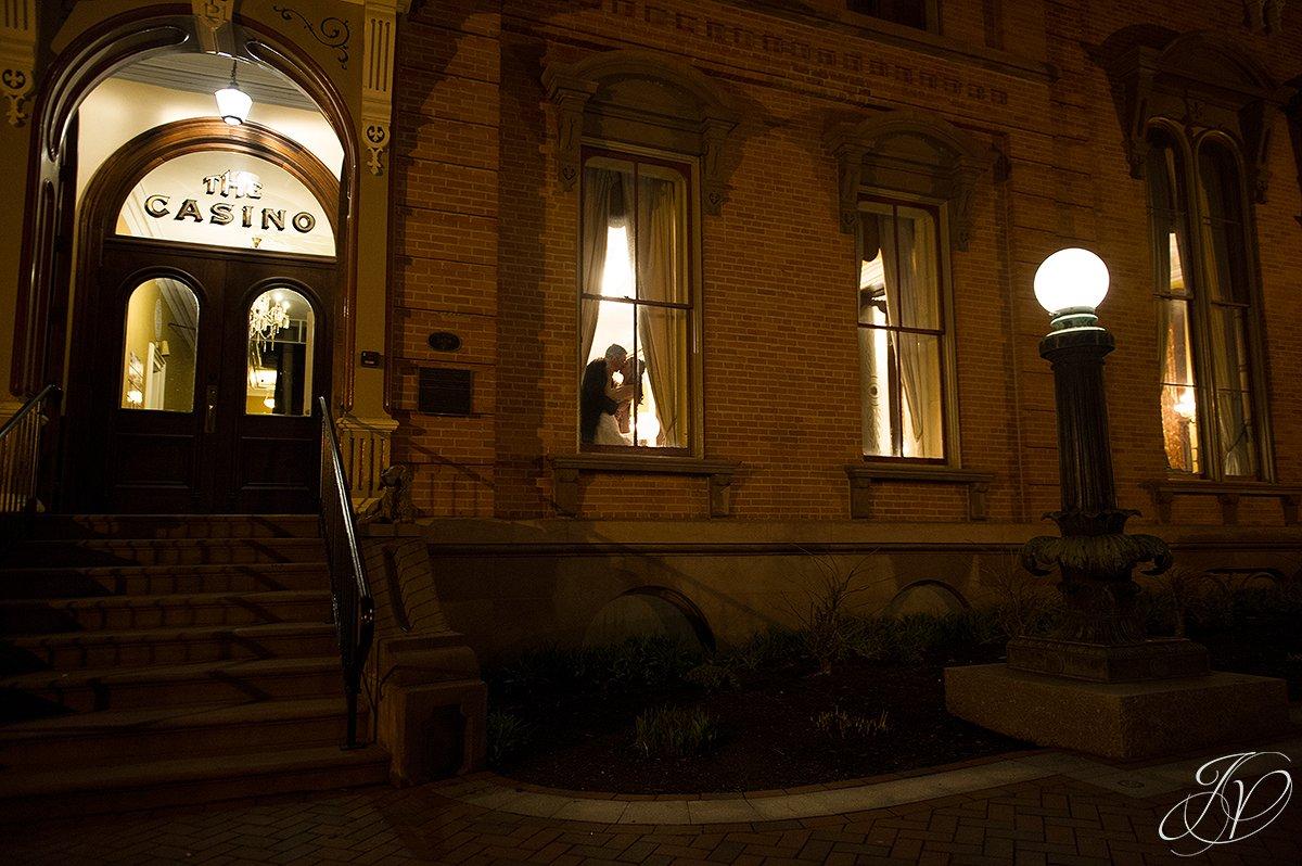 beutiful ending to wedding night, bride and groom in window at night, Saratoga Wedding Photographer, The Canfield Casino wedding