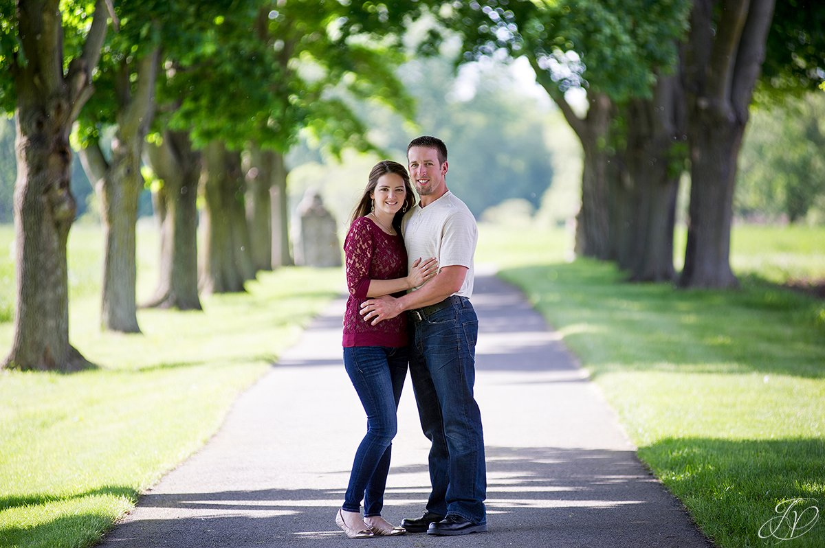 summer engagement photo with row of trees