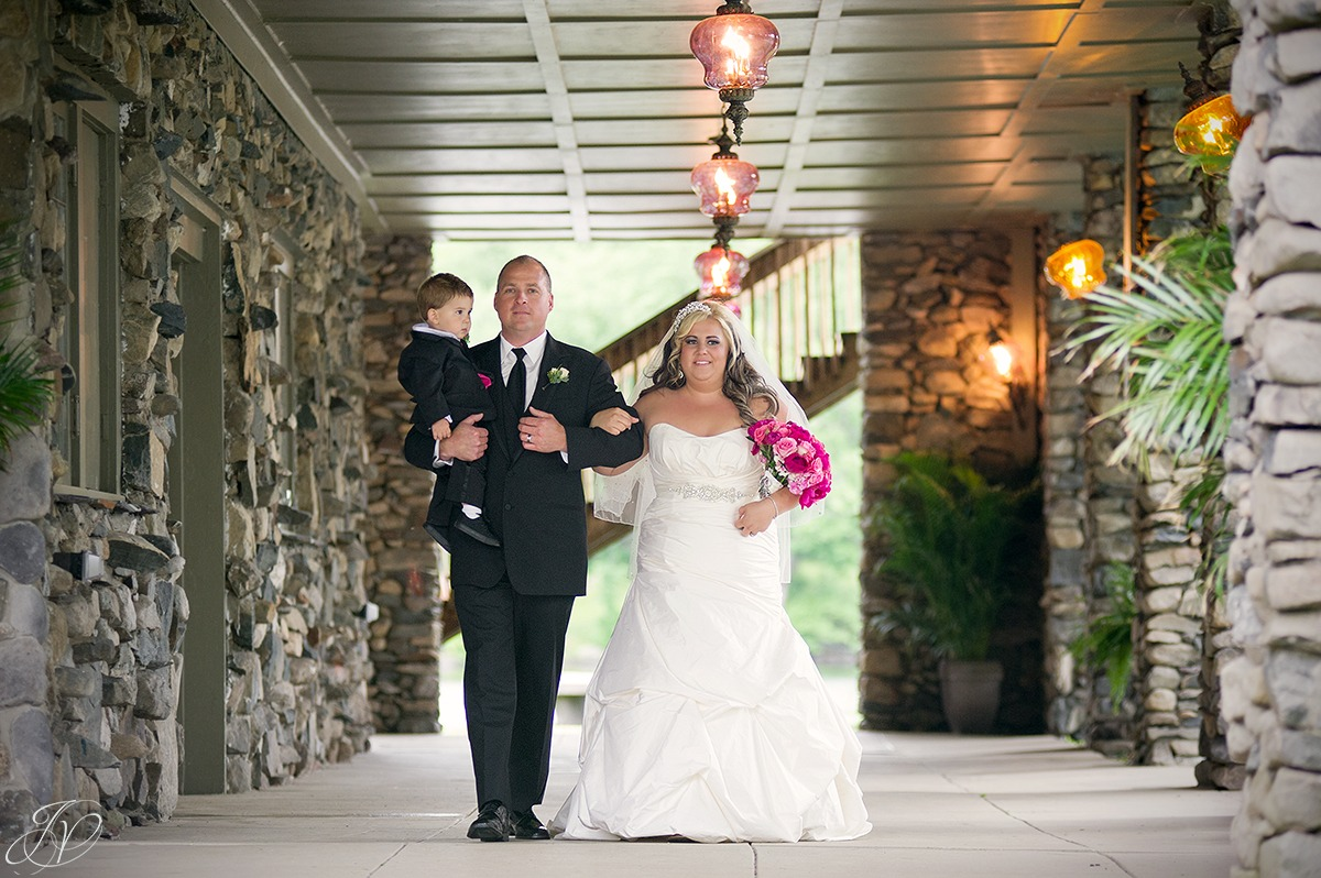 emotional shot of bride being walked down the aisle by father