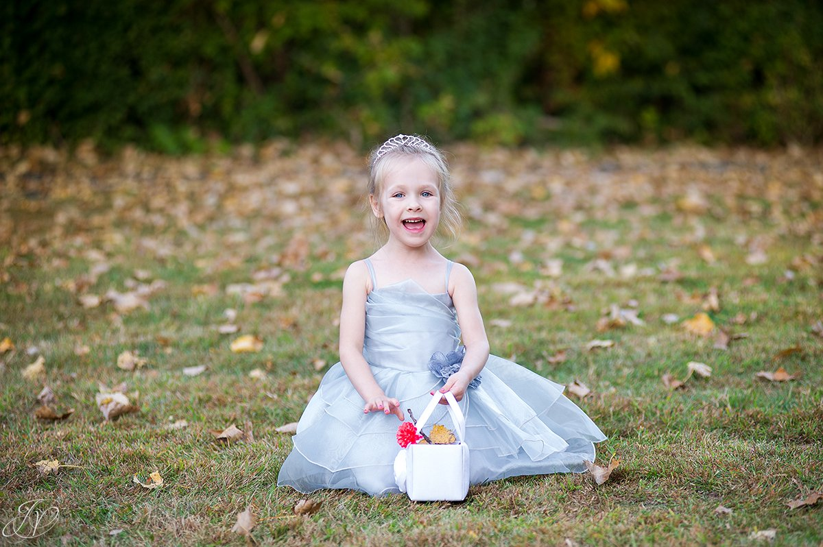 cute flower girl in the fall
