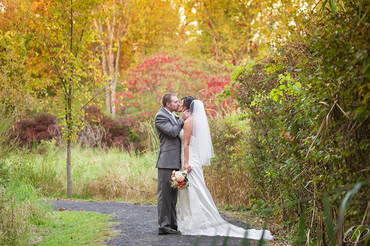 breath taking photo of bride and groom in the fall