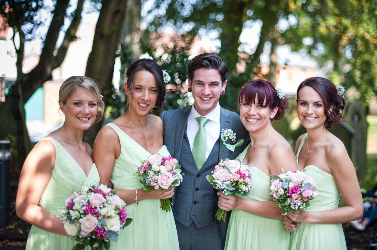 bridesmaids with guest at wedding