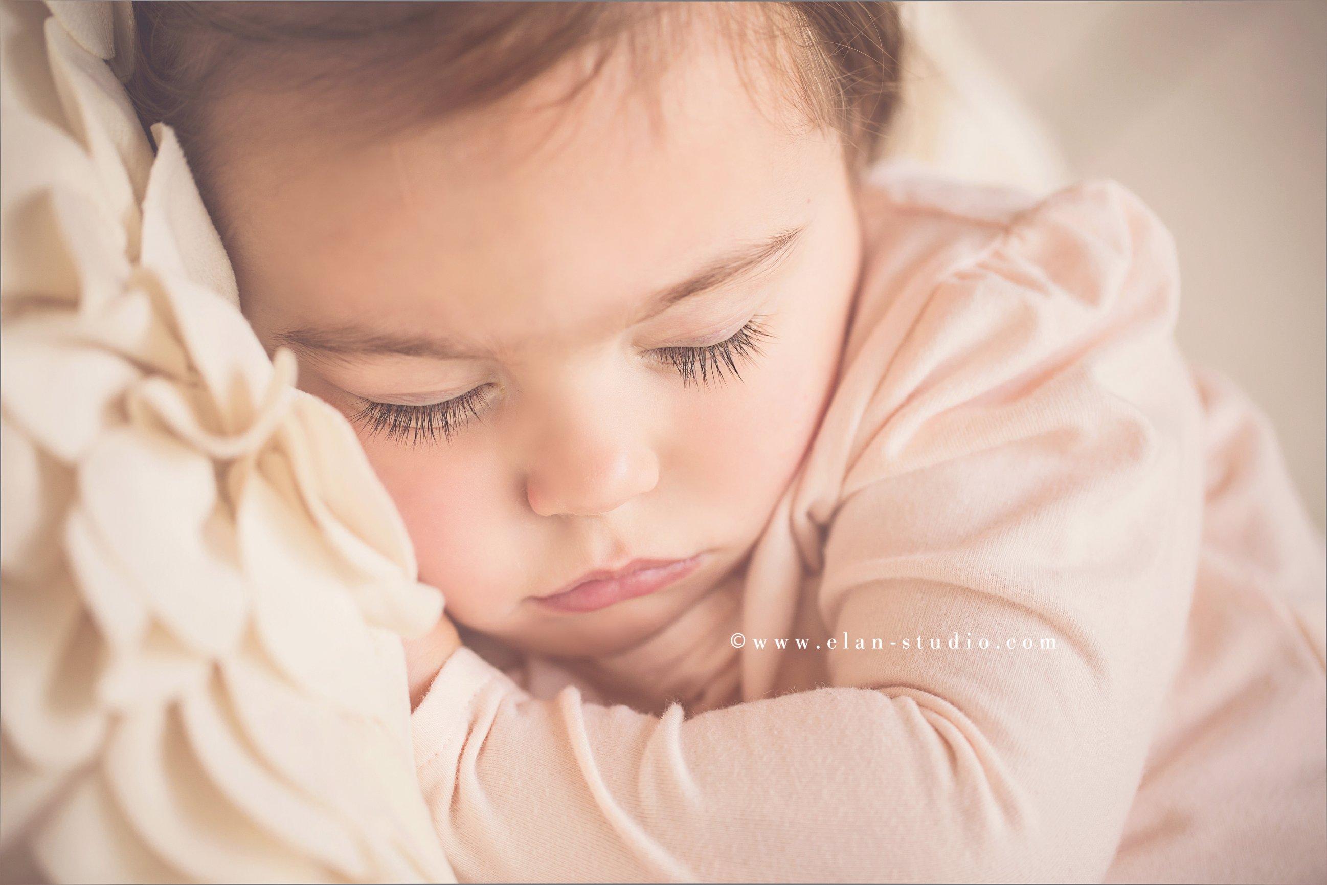 sleeping baby with long eyelashes