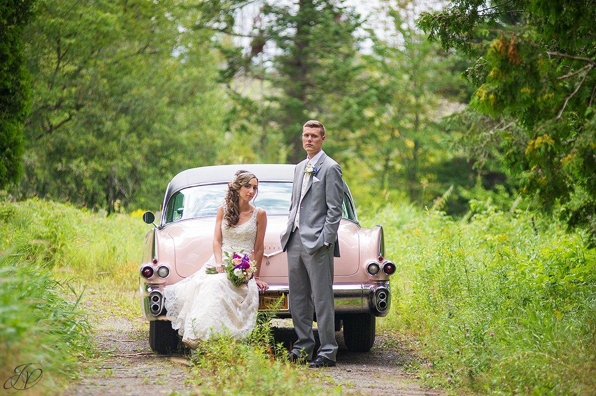 bride and groom on trail lake placid vintage car
