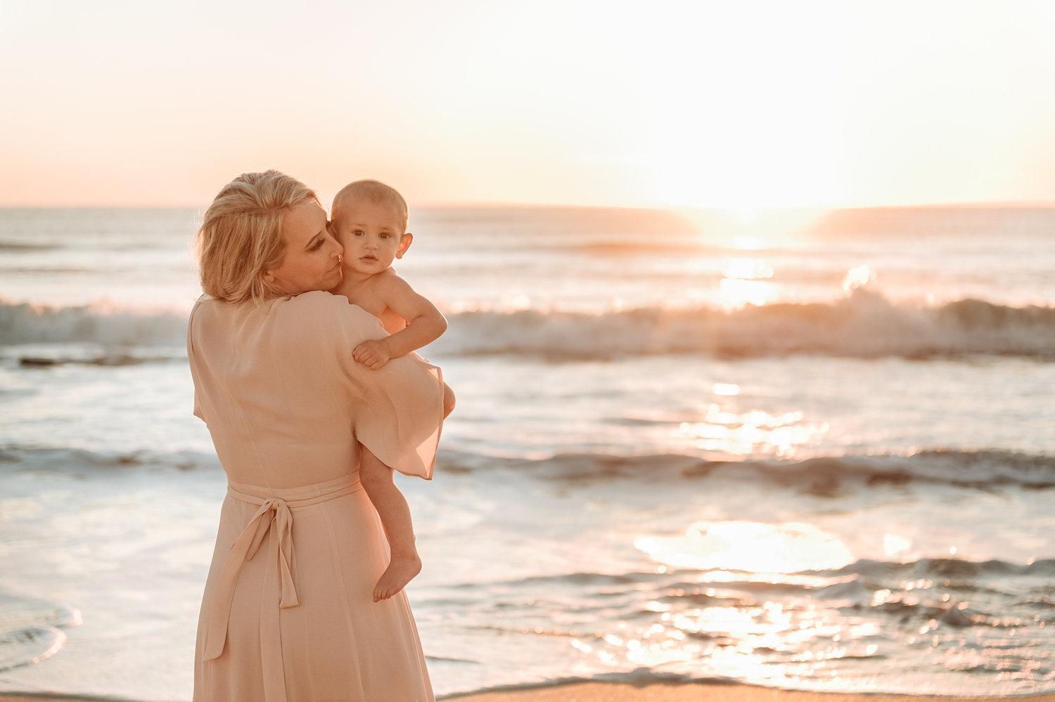 gorgeous mother nuzzling baby boy, sunrise motherhood session in Florida, Ryaphotos Baby Plan member