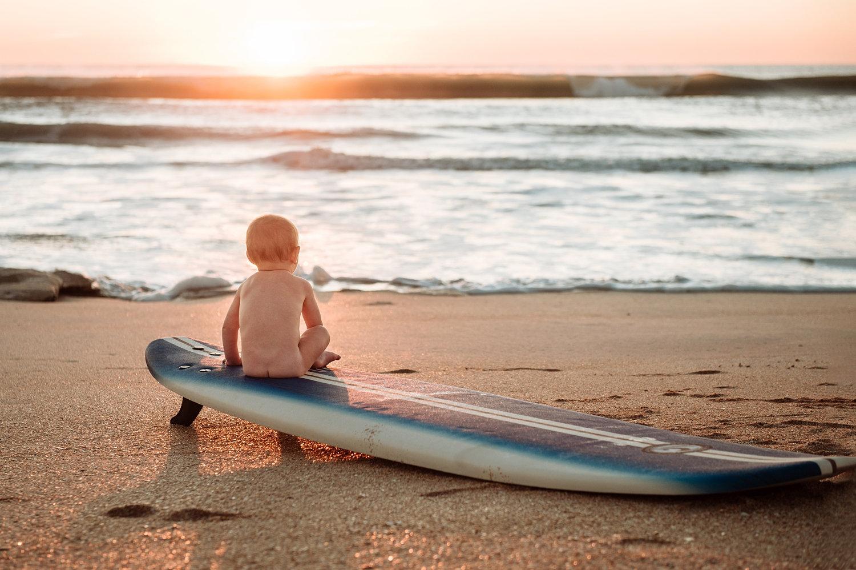 baby boy sitting on a surfboard at sunrise, sunrise baby session, Ryaphotos